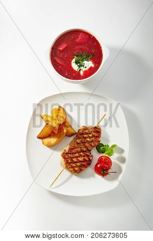 Chicken Skewer with Potato Wedges and Soup