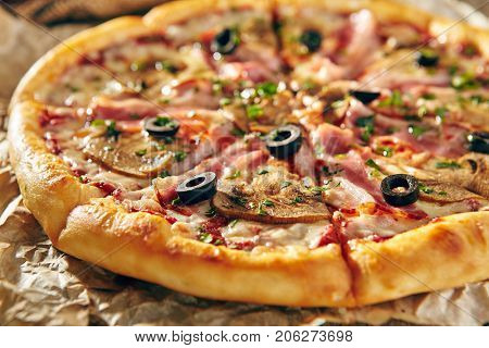 Pizza Restaurant Menu - Delicious Fresh Pizza with Bacon and Mushrooms. Pizza on Rustic Wooden Table with Ingredients