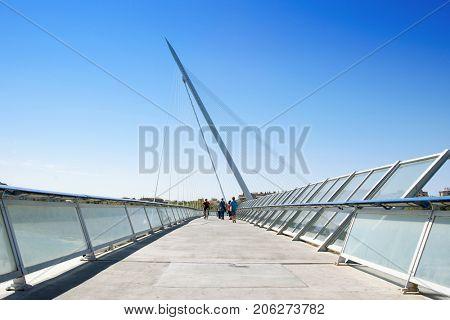 ZARAGOZA, SPAIN - AUGUST 19, 2017: A view of the Pasarela del Voluntariado bridge, above the Ebro River in Zaragoza, Spain, built for the international exposition Expo 2008