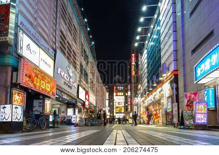 TOKYO, JAPAN - NOVEMBER 13, 2016: Cityscape of Ikebukuro district in Tokyo at night, Japan. Tokyo Metropolis is both the capital and most populous city of Japan.