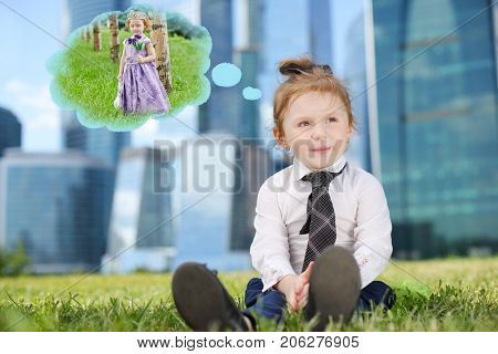 Little cute dreaming girl in tie on grass near skyskrapers, collage - dream about princess dress