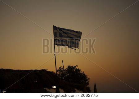 The Greek Flag Blowing In The Sunset