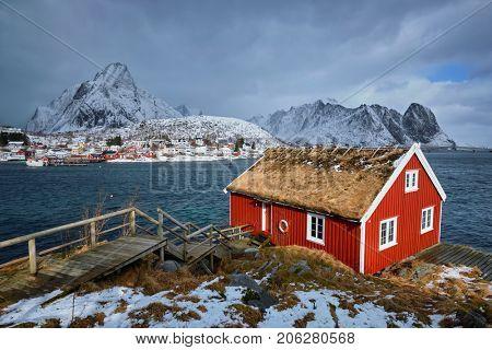 Traditional red rorbu house in Reine village on Lofoten Islands, Norway in winter