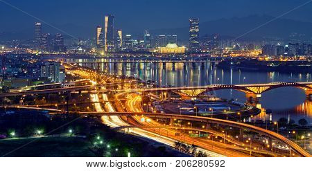 Aerial panorama of Seoul downtown cityscape and Seongsan bridge over Han River in twilight. Seoul, South Korea.
