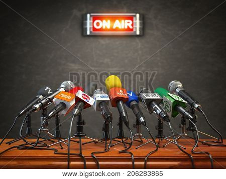 Press conference or interview on air.  Microphones of different mass media, radio, tv and press prepared for conference meeting. 3d illustration.