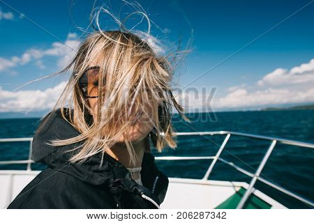 Hairstyle, woman in windy weather