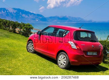 Greece, The island of Zakynthos 12.06.2017. View of the Ionian Sea. Zakynthos Island The Ionian Sea.red car SUZUKI by the sea