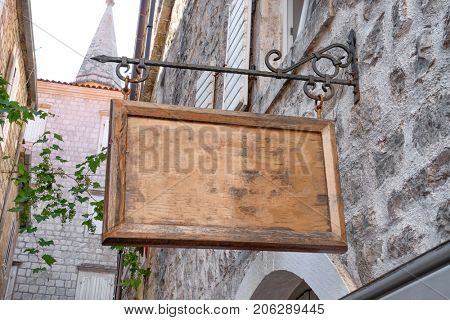 Signboard hanging on building outdoors