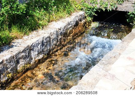 Ditch with water on sunny day