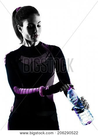 one young caucasian woman runner running jogger jogging drinking water isolated silhouette shadow on white background