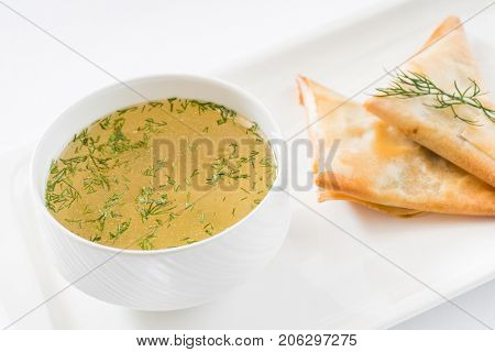 broth with pies