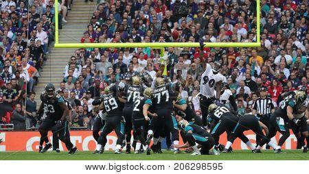 LONDON, ENGLAND - SEPTEMBER 24: Jason Myers of Jacksonville Jaguars kicks a field goal during the NFL match between The Jacksonville Jaguars and The Baltimore Ravens