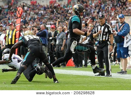 LONDON, ENGLAND - SEPTEMBER 24: Blake Bortles quarterback for Jacksonville Jaguars runs with the ball during the NFL match between The Jacksonville Jaguars and The Baltimore Ravens