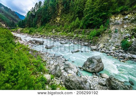 Mountain Valley. Beautiful river landscape and mountain forest in Nepal. Trekking route to Everest Base Camp, Himalayas. Holidays, sport, recreation. Travel background. Beautiful nature landscape