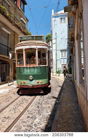 Old Tram Number 28 On The Narrow Street Of Alfama. Lisbon. Portugal