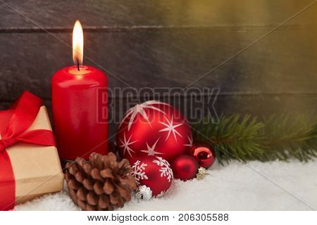 Burning candle with flame as christmas background
