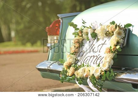Beautiful wedding car with plate JUST MARRIED outdoors