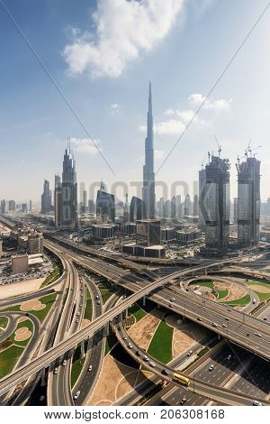 Big transport junction Burj Khalifa and other skyscrapers in Dubai, UAE
