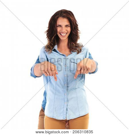 happy woman with man behind her pointing down to something on white background