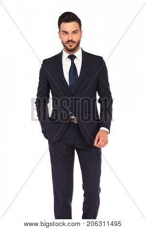 un shaved young smiling business man standing on white background