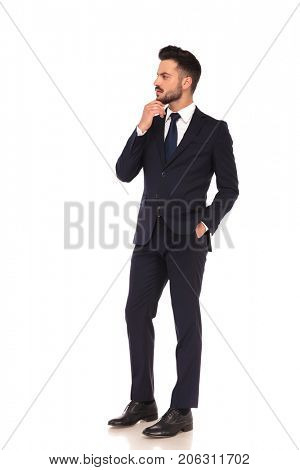 side view of a thoughtful young business man looking to side on white background