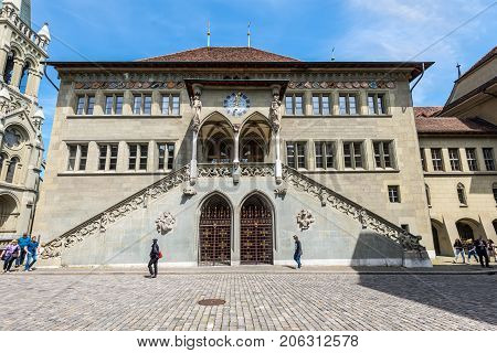 Bern Switzerland - May 26 2016: Facade of Old Town Hall in Bern Switzerland World Heritage Site by UNESCO. People in the street.