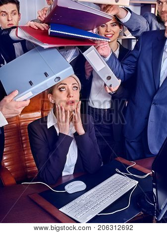 Mad business people office. Team people are unhappy with their leader. Intern woman manager does not cope with his duties. New employee on the first working day. Documents for signature.