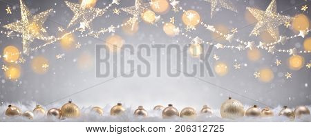 Golden Christmas balls and lights in winter setting