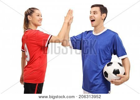 Female and a male soccer player high-fiving each other isolated on white background