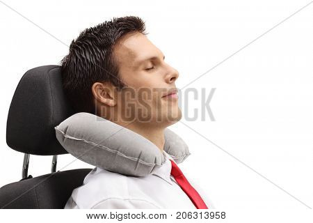 Formally dressed guy with a neck pillow sleeping in a seat isolated on white background