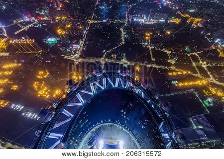 GUANGZHOU, CHINA - AUG 21, 2015: People on observation deck of Canton Tower at night, This is second tallest TV tower in world