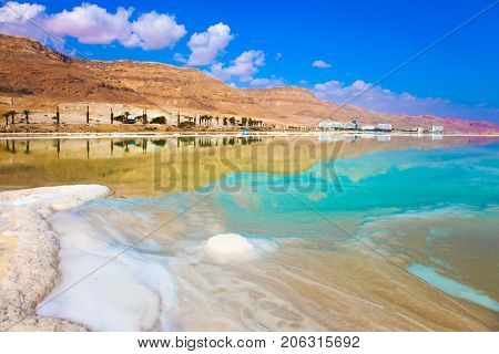 Reduced water in the very salty Dead Sea. The evaporated salt. Therapeutic Dead Sea, Israel. The concept of medical and ecological tourism