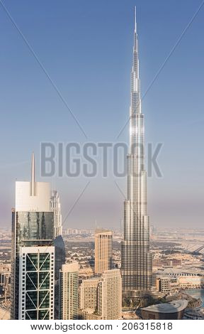 DUBAI, UAE - JAN 9, 2017: Millenium Tower and Burj Khalifa, Burj Khalifa - skyscraper in height of 828 meters in Dubai, tallest structure in world