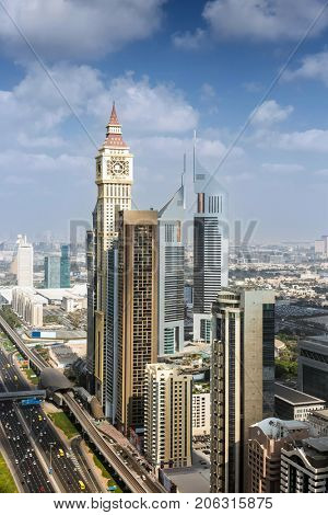 DUBAI, UAE - JAN 8, 2017: Al Yaqoub Tower, Complex Emirates Towers, Al Yaqoub Tower is 328 m skyscraper on Sheikh Zayed Road. The tower topped out in 2010.