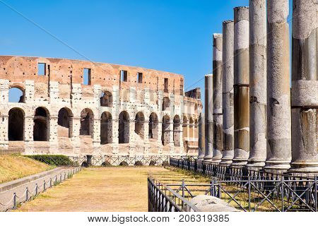 Ruins of the Colosseum and the columns next to the temple of Venus in central Rome on a sunny summer day