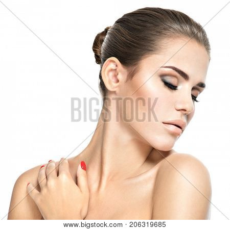 Portrait of young woman with closed eyes. Woman touching body