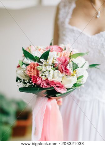 Wedding Bridal Bouquet In Bride's Hands