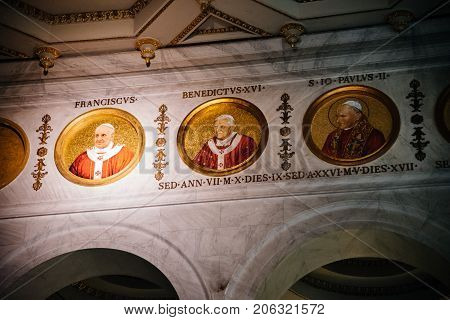 Rome Italy - August 21 2016: Interior view of Papal Basilica of St. Paul outside the Walls . It is one of Rome's four major basilicas. Detail of paintings of last popes