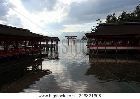 The Iconic Gate Of Shinto Shrine In Miyajima. It's Close To Itsukushima Shrine