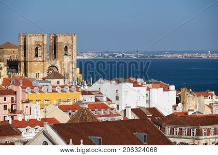 The Lisbon Cathedral  Surrounded By Residential Houses Of Alfama. Lisbon. Portugal