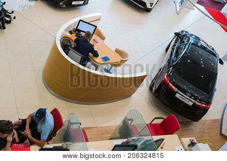 Russia, Kirov - August 21, 2017: Manager and car in showroom of dealership Toyota in Kirov city in 2016