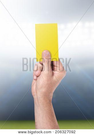 Yellow Card On Stadium Background