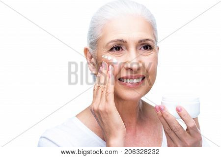 Senior Woman Applying Cream