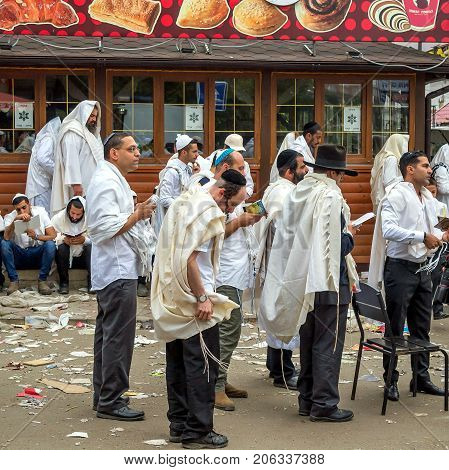 Uman Ukraine - 21 September 2017: Rosh Hashanah Jewish New Year 5778. Mass prayer of pilgrims of Hasidim on the street of the city of Uman where Rebbe Nachman the founder of Hasidism is buried.