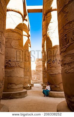 Girl admiring beauty of famous ancient temple in Luxor, Egypt