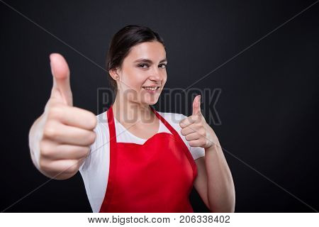 Smiling Supermarket Seller Gesturing Thumbs Up