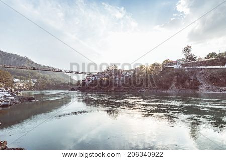Cityscape Of Rishikesh At Sunset, Holy Town On The Ganges River And Popular Hipster Travel Destinati