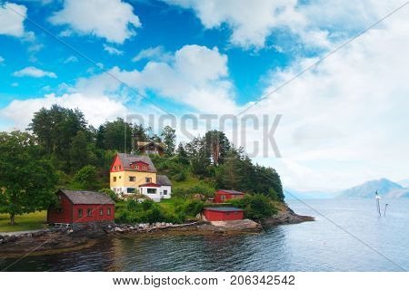 Typical norwegian landscape with red house
