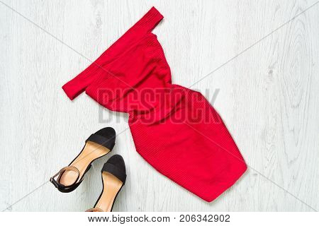 Red Dress With Downcast Shoulders, Black Shoes. Fashionable Concept.