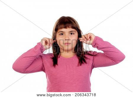 Pretty girl with pink t-shirt covering her ears isolated on a white background